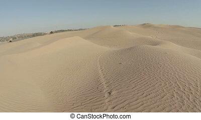 Yellow desert dunes and sky aerial.