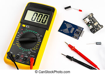 Yellow digital multimeter electronic measurement device tool with red and black cables microc chip circuit board led and micro controller isolated white background. Installation service concept
