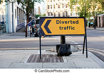Yellow diverted traffic road sign in a UK city street