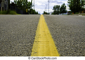 yellow dividing line on a highway in city