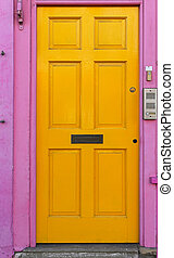 Yellow door with pink doorway in Portobello London