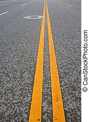 Yellow double line on the asphalt road