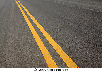 yellow double solid line on the road
