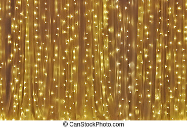 Yellow drape with many light bulb as background
