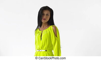 Isolated video of a glamorous young woman in a yellow dress clubbing