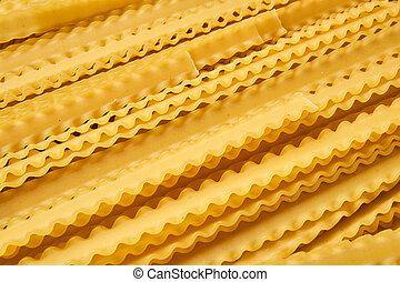 background of dried pasta mafaldine with curving edges