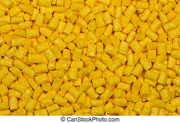 yellow dyed and glass filled polymer granulate