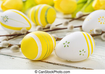 Yellow easter eggs on a rustic background