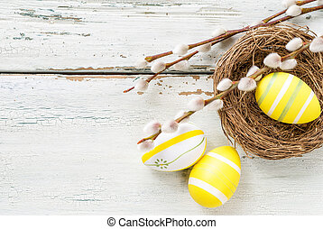 Yellow easter eggs on a wooden background with copy space