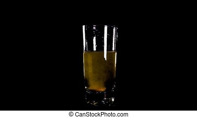 yellow effervescent tablet falling in glass of water1 - Slow...