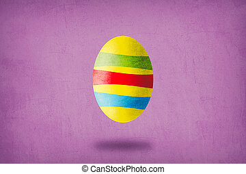 Yellow egg with green, red and blue stripes on purple background.