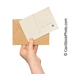 yellow envelope with vintage blank card in the hand