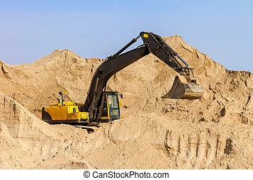 Yellow Excavator at Construction Site - Working Yellow...