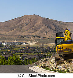 Yellow Excavator on a construction site in Utah
