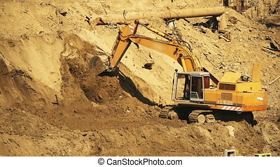Yellow excavator working on a construction site