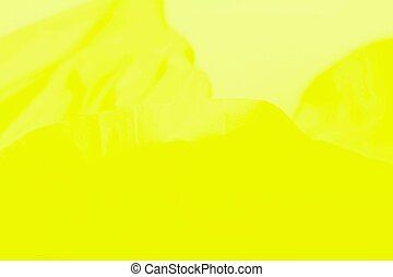 Yellow fabric background, vivid abstract blurred background