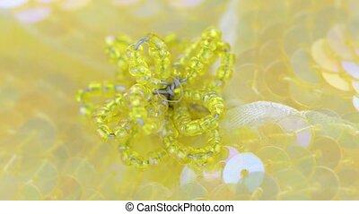 Yellow fabric flower