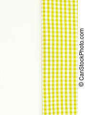 Yellow fabric, kitchen towel with checkered pattern, isolated on white background isolated