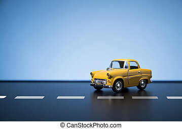 Yellow fifties toy model car.