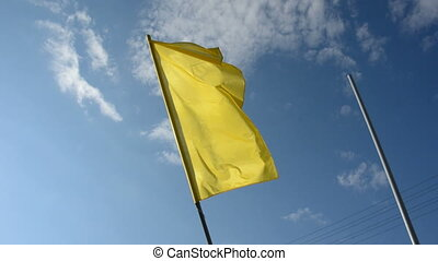 yellow flag on sky background