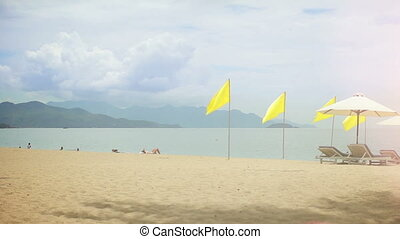 Yellow flags on a Beach.