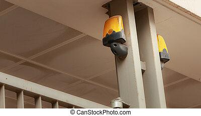 yellow flashing light over a garage door
