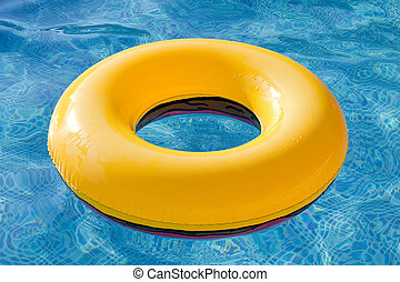 Yellow float floating in the pool with blue water