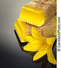 yellow flower soap handmade on a black background