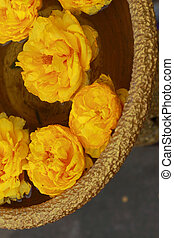 Yellow flowers in a bowl