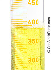 yellow fluid in a large testtube on white background