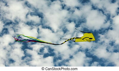 Yellow flying  kite in the cloudy blue sky. Full HD.