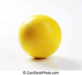 Yellow foam ball - Closeup of a yellow foam ball - studio