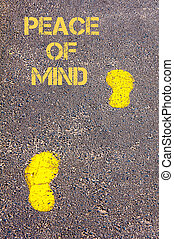 Yellow footsteps on sidewalk towards Peace of Mind message, Serenity conceptual image
