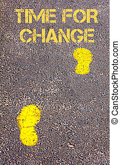 Yellow footsteps on sidewalk towards Time for Change message