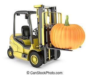 Yellow fork lift truck lifts orange pupmkin
