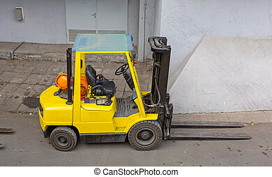 Yellow Forklift Outside