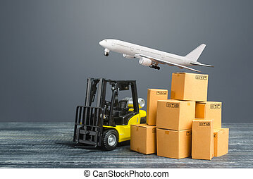 Yellow Forklift truck and cardboard boxes and freight plane. Production, transport, cargo storage. Freight shipping. retail. Transportation logistics infrastructure, import and export goods delivery.