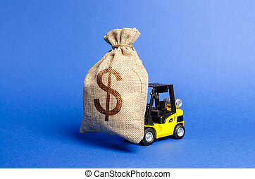 Yellow forklift truck carries a big bag of money. Attracting investment in the development and modernization of production and business projects. Revenue, profit, sales. super profit. copy space