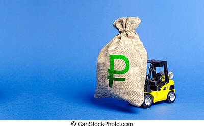 Yellow forklift truck carries bag of russian ruble money. Attracting investment in development, modernization of production and business. Revenue, profit, liquidity. profit fixation. capital migration