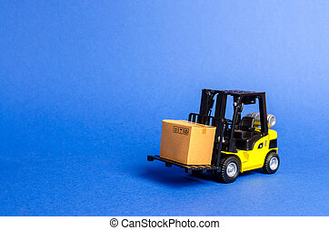 Yellow Forklift truck with cardboard box. Increase sales, production of goods. transportation, storage of cargo. Freight shipping, delivery of goods. logistics industries. retail. copy space