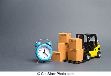 Yellow Forklift truck with cardboard boxes and a blue alarm clock. Express delivery concept. Temporary storage, limited offer and discount. Optimization of logistics and delivery, improving efficiency