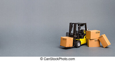 Yellow Forklift truck with cardboard boxes. Increase sales, production of goods. transportation, storage of cargo and goods. Freight shipping, delivery of goods. Logistics. retail. Banner, copy space