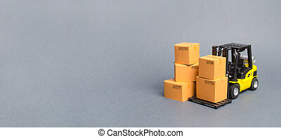 Yellow Forklift truck with cardboard boxes. Service storage of goods in a warehouse, delivery and transportation. Freight shipping, delivery. Import and export, commodity exchange. Banner, copy space