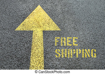 Yellow forward road sign with Free Shipping word on the asphalt road.