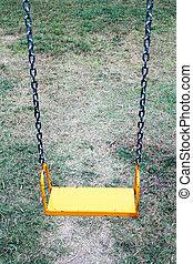yellow garden swing hanging
