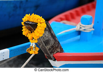 Yellow garlang on the head of boat.