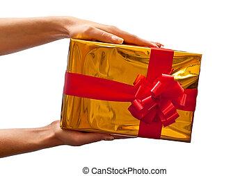 Yellow gift box in woman's hand