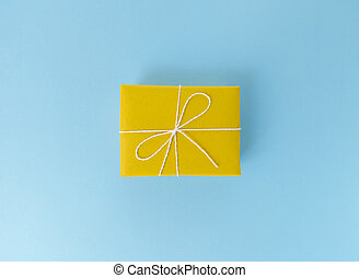 Yellow gift box on a blue background.