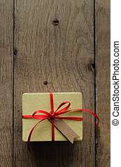 Yellow Gift Box with Red Ribbon and Vintage Style Blank Tag