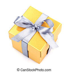 yellow gift box with silwer ribbon